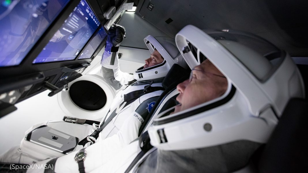 Two astronauts inside flight simulator (SpaceX/NASA)