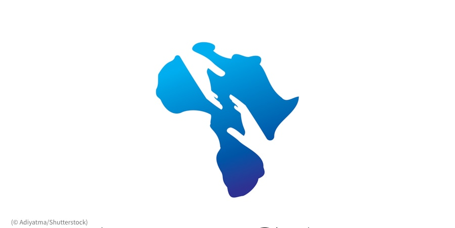 Drawing of Africa with hands inserted (© Adiyatma/Shutterstock)