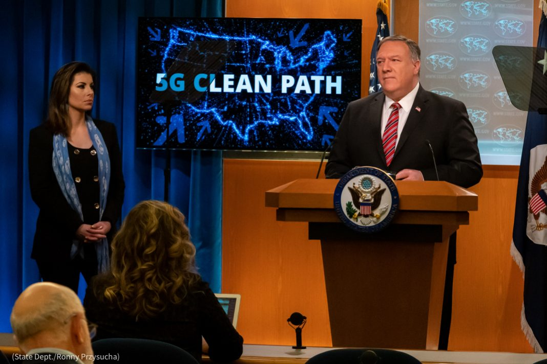 Secretary Pompeo speaking at lectern, with Morgan Ortagus to his right (State Dept./Ronny Przysucha)