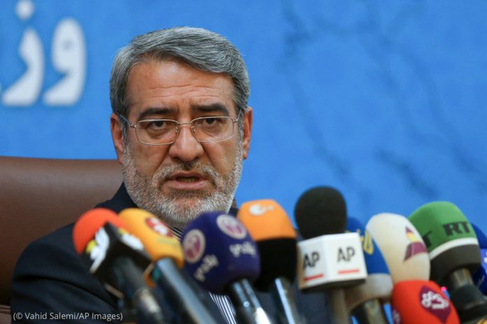 Abdolreza Rahmani Fazli speaking into many microphones (© Vahid Salemi/AP Images)