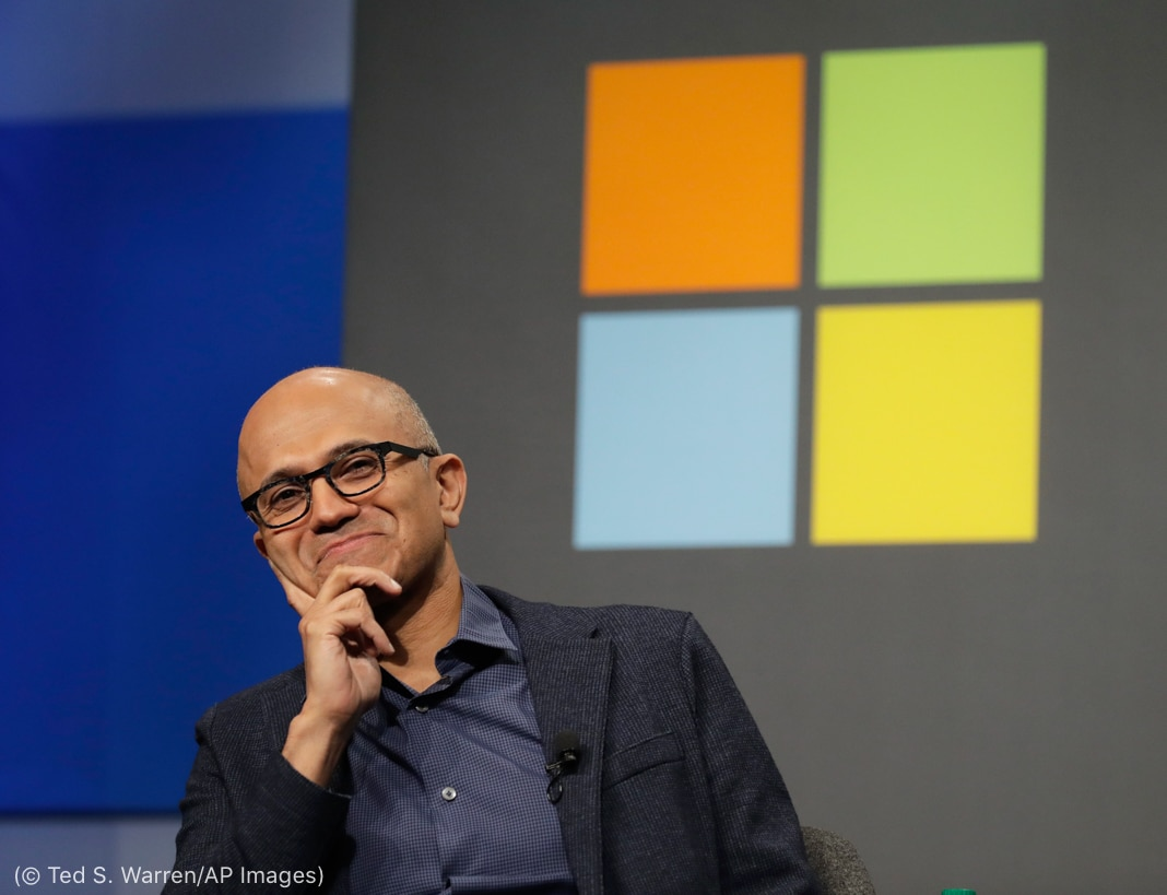 Satya Nadella, souriant (© Ted S. Warren/AP Images)