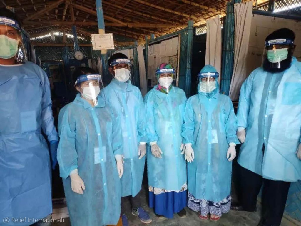 People wearing protective gear (© Relief International)