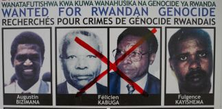 "Photos on a ""Wanted for Rwandan Genocide"" poster with two of the same man in the center crossed out with a red marker (© Simon Wohlfahrt/AFP/Getty Images)"