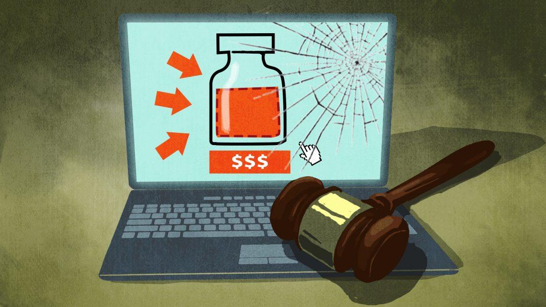 ایک تصویری خاکہ جس میں جج کا ہتھوڑا ایک لیپ ٹاپ پر رکھا ہوا ہے اور سکرین پر ویکسین کے اشتہار کی ڈرائنگ بنی ہوئی ہے۔ (State Dept./D. Thompson)