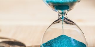 Hourglass with sand dropping (Shutterstock)