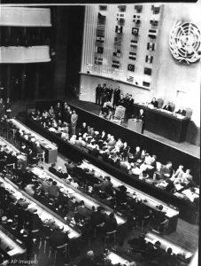 Delegates sitting during a U.N. assembly (© AP Images)