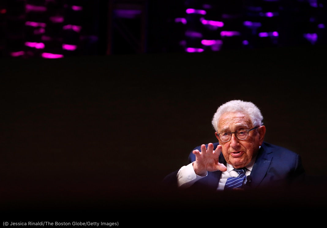 Henry Kissinger gesturing with right hand (© Jessica Rinaldi/The Boston Globe/Getty Images)