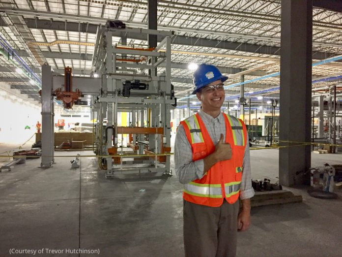 Man in hardhat standing in a manufacturing building (Courtesy of Trevor Hutchinson)