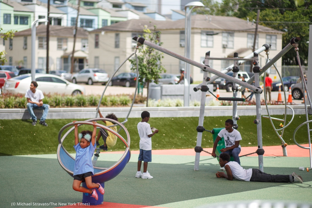 Children on playground (© Michael Stravato/The New York Times)