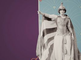 Image of helmeted woman holding staff with flag as cape (State Dept.)
