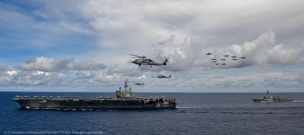Helicopters and planes flying near aircraft carrier and ship (U.S. Navy/Mass Communication Specialist 3rd Class Olivia Banmally Nichols)