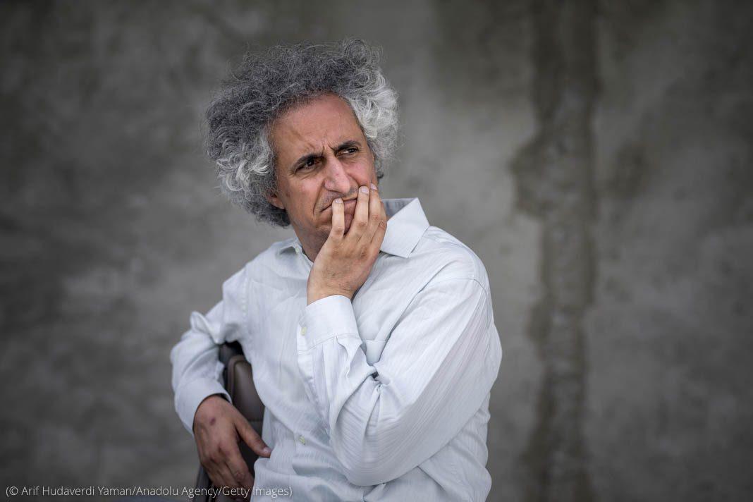 Man sitting holding chin with his hand (© Arif Hudaverdi Yaman/Anadolu Agency/Getty Images)