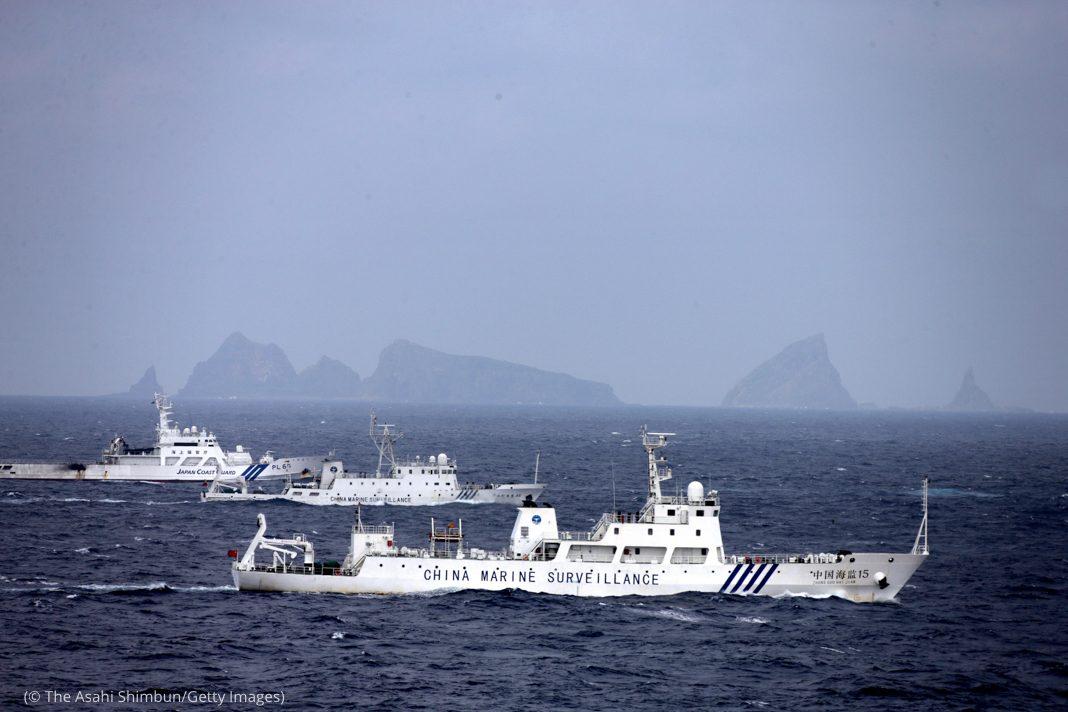 Three ships cruising near islands (© The Asahi Shimbun/Getty Images)