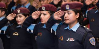 Female Nepali police saluting (State Dept.)