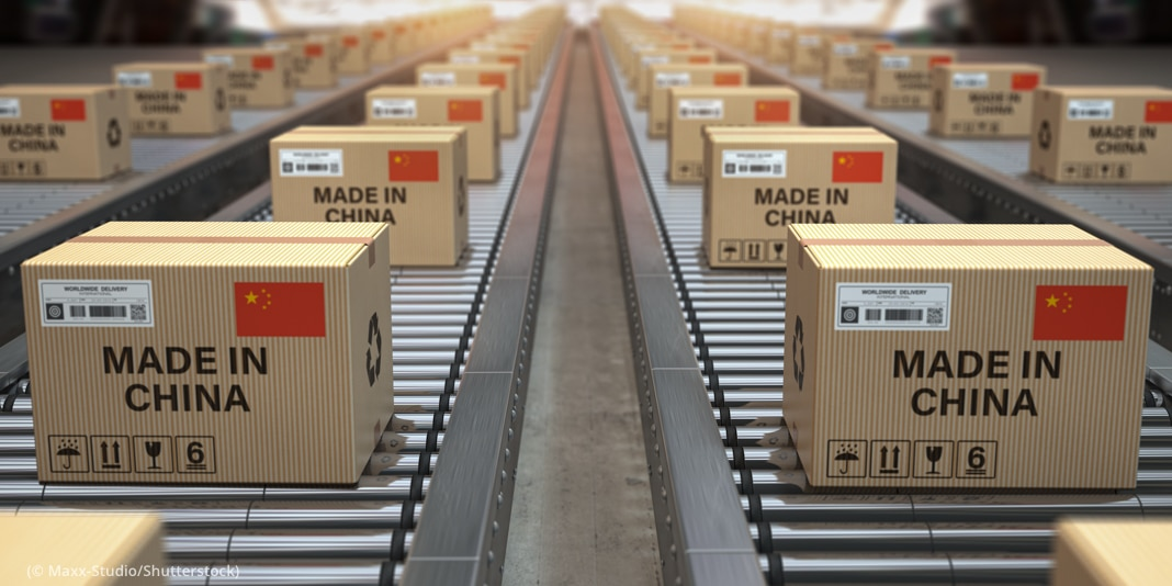 Boxes on assembly line (© Maxx-Studio/Shutterstock)