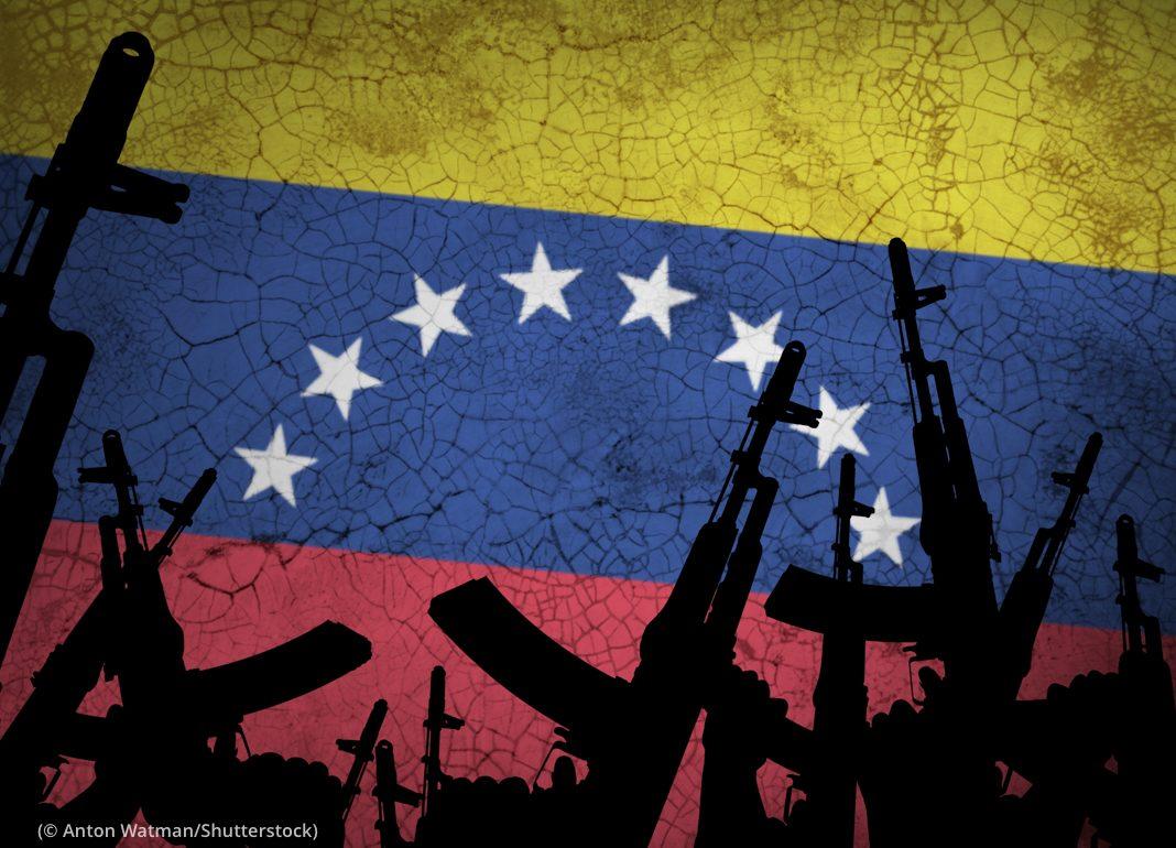 Illustration of guns against background representing Venezuelan flag (© Anton Watman/Shutterstock)
