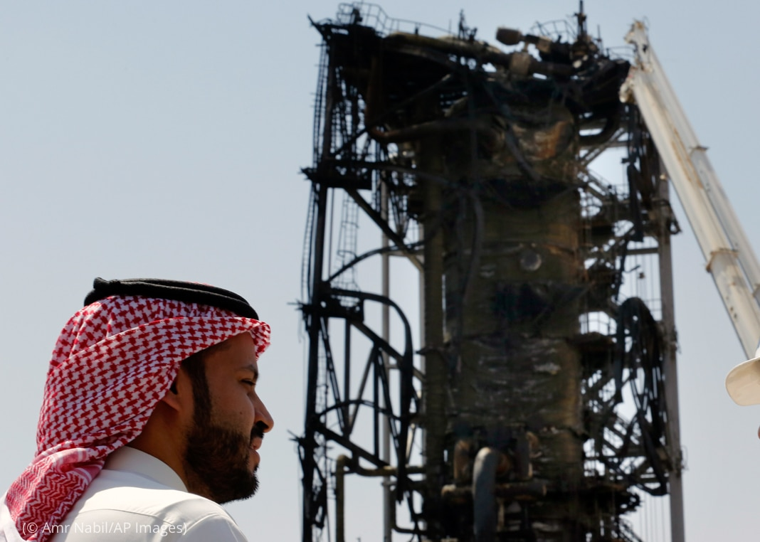 Man standing in front of damaged tower (© Amr Nabil/AP Images)