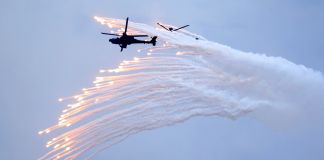 Attack helicopter firing flares (© Chiang Ying-ying/AP Images)