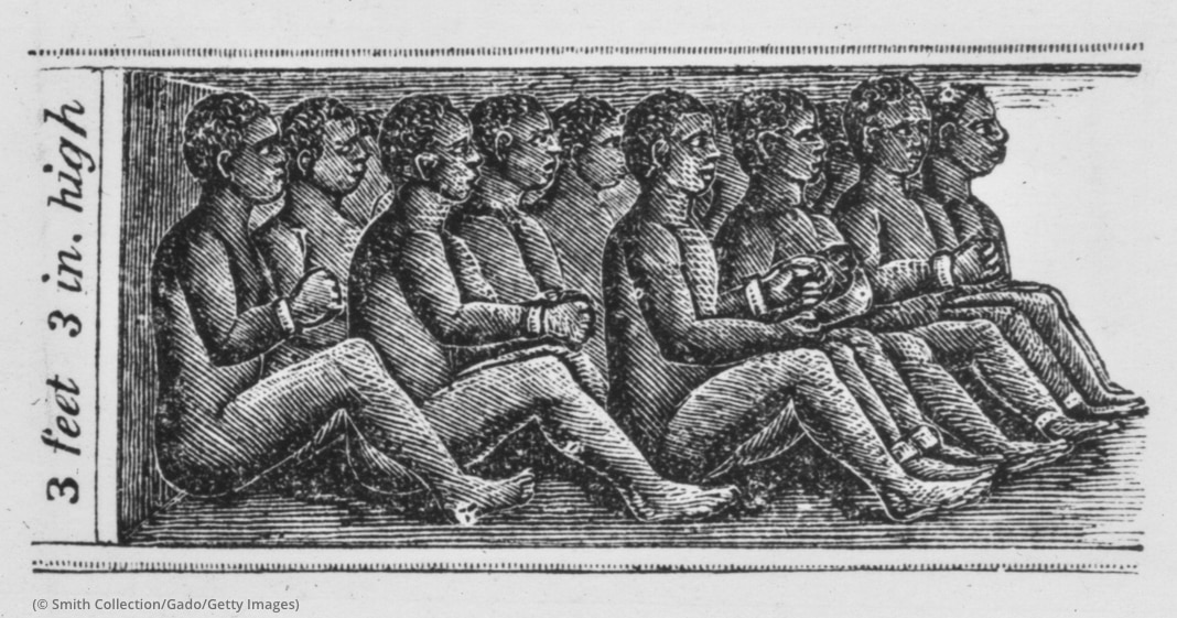 Engraving of Africans chained, naked and crowded in tight rows into small space (© Smith Collection/Gado/Getty Images)