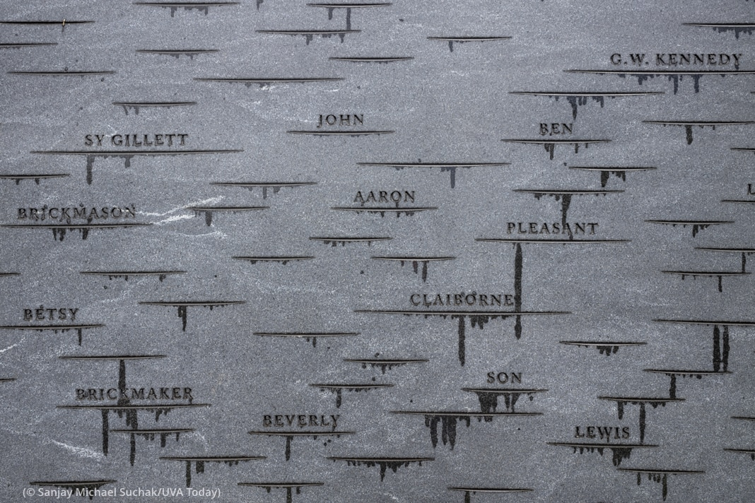 Close-up view of names and characterizations inscribed in monument (© Sanjay Michael Suchak/UVA Today)