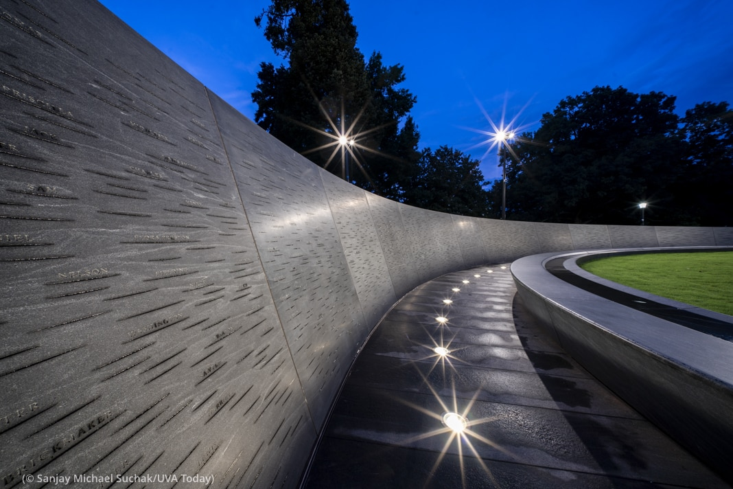 View of walkway with embedded lights in circular monument at dusk (© Sanjay Michael Suchak/UVA Today)