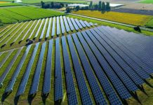 Solar panels in agricultural field (© Fly_and_Dive/Shutterstock)