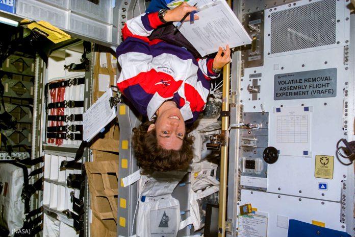 Woman floating upside down in space shuttle (NASA)