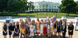 Melania Trump standing in front of White House with group of children (White House/Andrea Hanks)