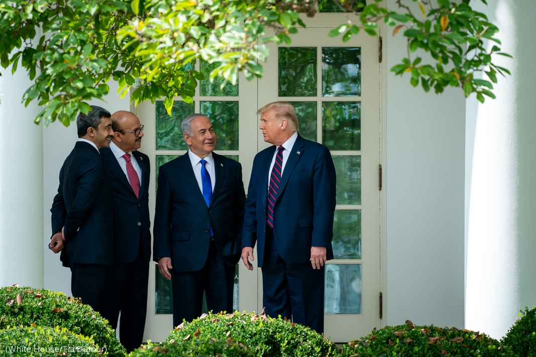 President Trump standing with three men outside French doors at the White House (White House/Tia Dufour)
