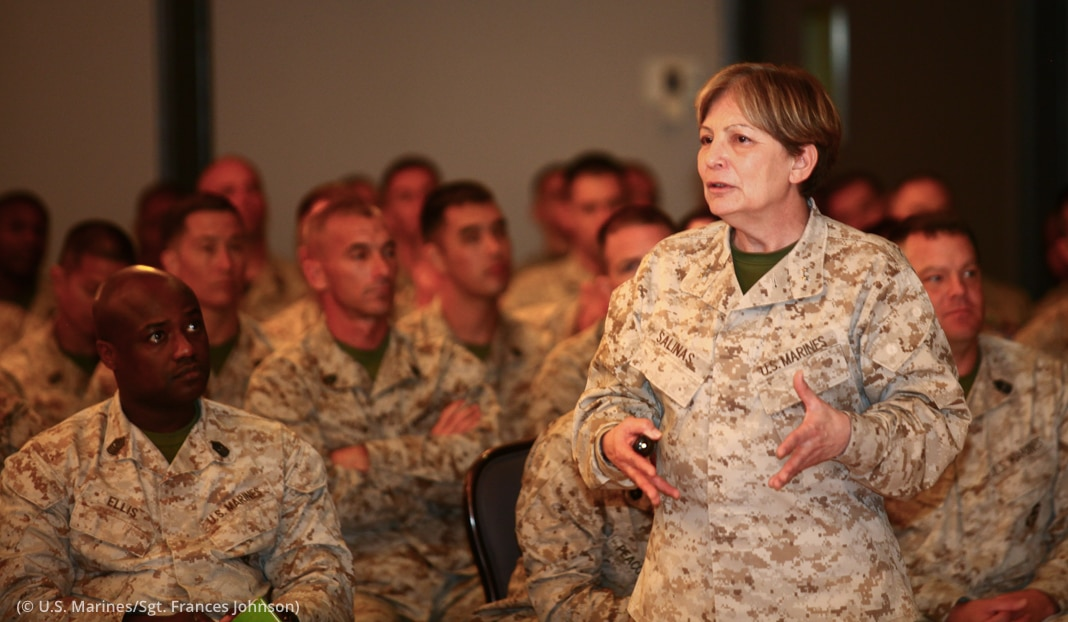 Uniformed woman speaking in front of group of uniformed people (U.S. Marines/Sergeant Frances Johnson)