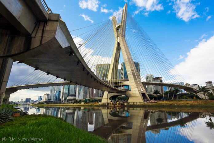 Cable-stayed bridge spanning river (© R.M. Nunes/Alamy)