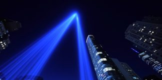 Beams of blue light rising up alongside skyscrapers (© Timothy A. Clary/AFP/Getty Images)