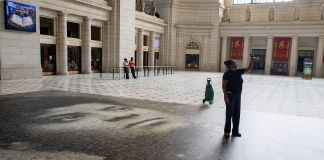Woman taking selfie with Ida B. Wells mural in Union Station (© Tasos Katopodis/Getty Images)