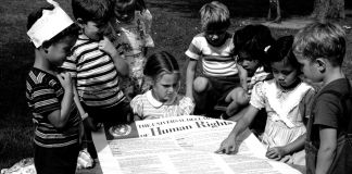Children looking at a large printout of the Declaration of Human Rights (© Universal History Archive/Getty Images)