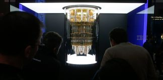 People looking at quantum computer (© Ross D. Franklin/AP Images)