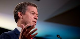 Sam Brownback, Ambassador at Large for International Religious Freedom, speaking(© Andrew Harnik/AP Images)