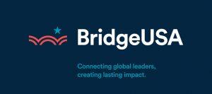 """رسم بياني يحتوي نصًا يقول 'بريدج يو إس إيه': جسر للتواصل بين قادة العالم وإحداث تأثير دائم"""" (State Dept.)"""