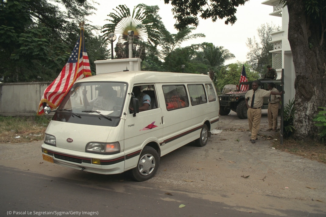 Van with U.S. flag leaving compound (© Pascal Le Segretain/Sygma/Getty Images)