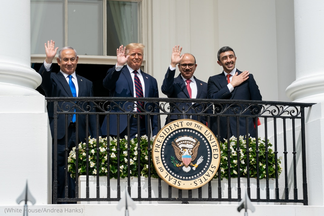 President Donald Trump and other men waving from White House balcony (White House/Andrea Hanks)