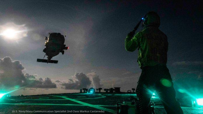 Night Flight Operations on deck of aircraft carrier (U.S. Navy/Mass Communication Specialist 2nd Class Markus Castaneda)
