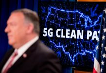 Mike Pompeo standing in front of illuminated map of the United States with words 5G Clean Path written on it (© Andrew Harnik/AP Images)