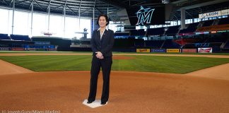 Woman standing at home plate on a baseball field in a stadium (© Joseph Guzy/Miami Marlins)