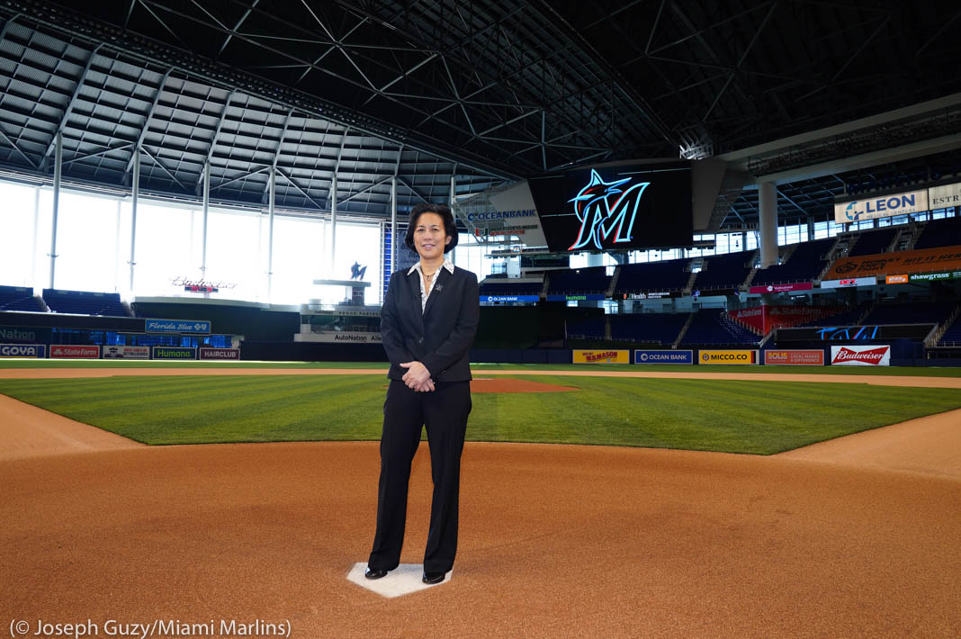 Woman standing on baseball field in stadium (© Joseph Guzy/Miami Marlins)