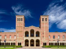 Brick-and-tile building with arches and two towers (© Ken Wolter/Alamy)