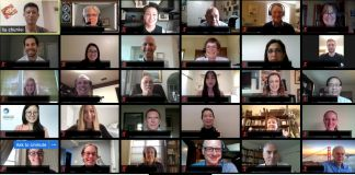 Screen grab of an online meeting with faces on multiple small screens (State Dept.)
