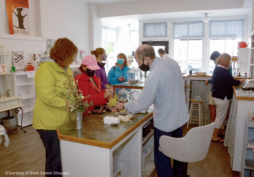 People standing at several counters in a small store (Courtesy of Bath Sweet Shoppe)