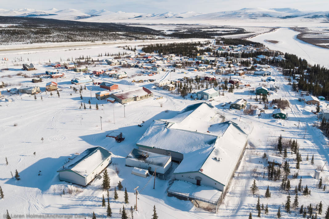 Overhead view of village covered in snow (© Loren Holmes/Anchorage Daily News)