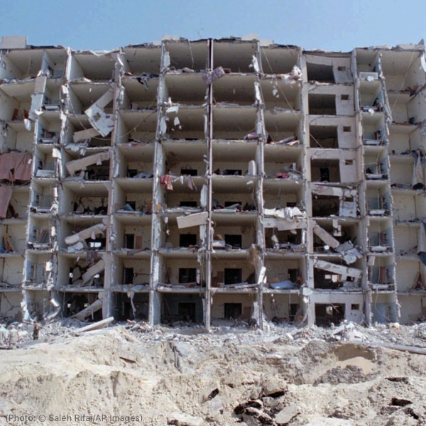 Multi-story building with front wall blasted off (© Saleh Rifai/AP Images)