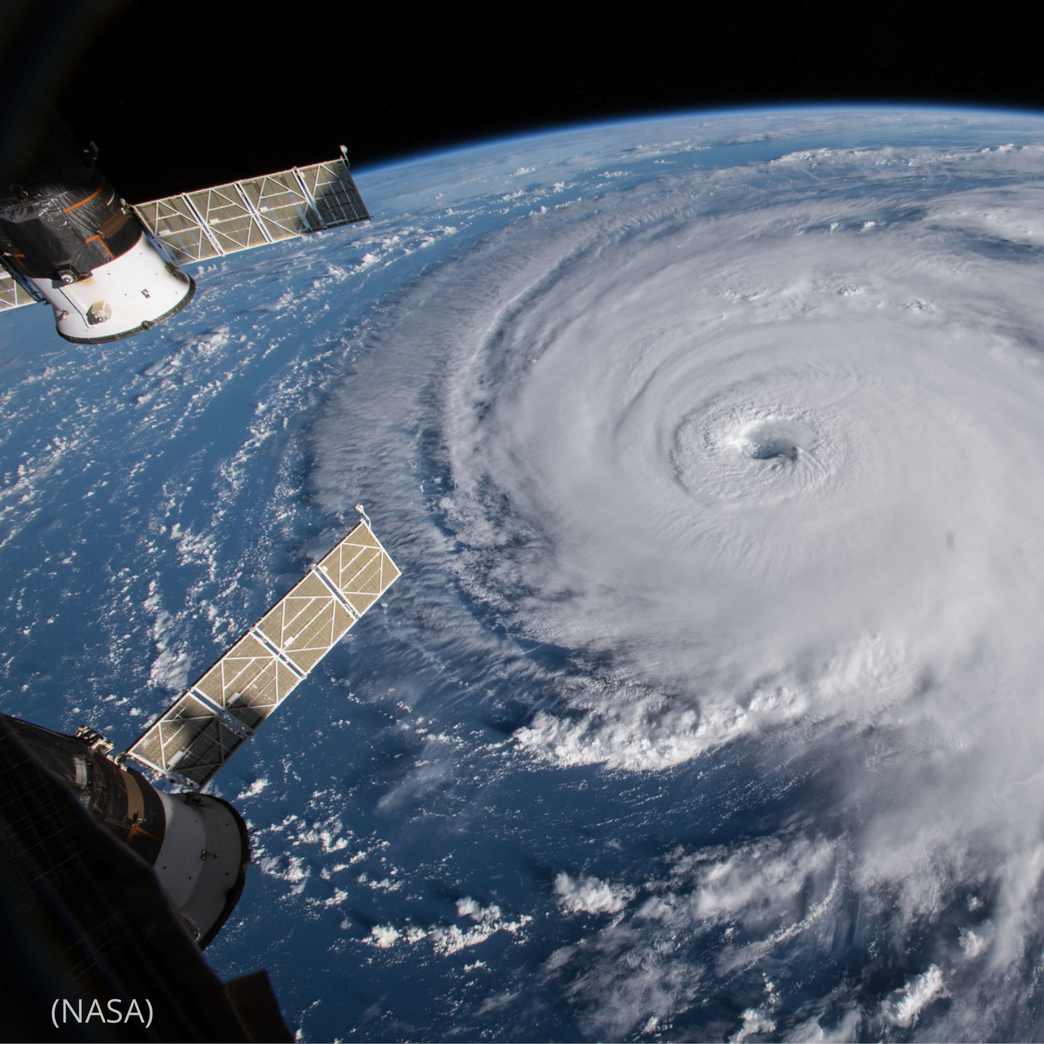 Satellites moving in space over hurricane (NASA)
