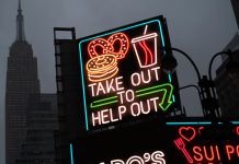 "A billboard in midtown Manhattan reads ""Take Out To Help Out (© Mark Lennihan/AP Images)"